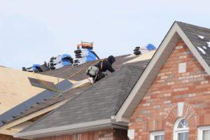 Roofers repairing a home in Manassas, Virginia
